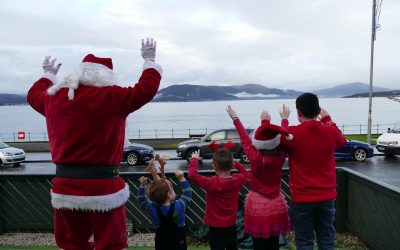 Santa delivers festive cheer with socially distanced doorstep visits